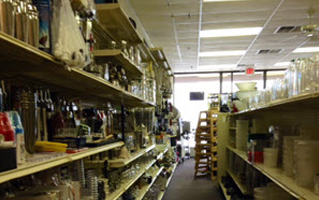 An aisle of small restaurant supplies at Skelton's Inc.